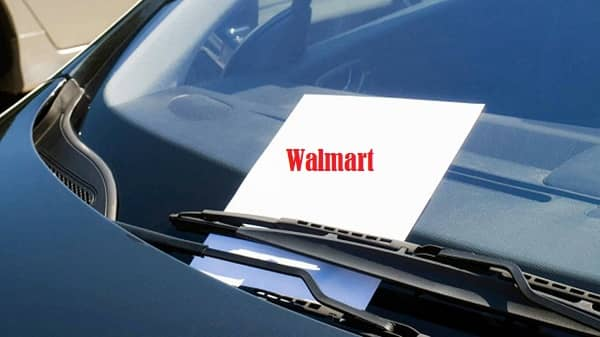 Is it legal to put flyers on cars at Walmart